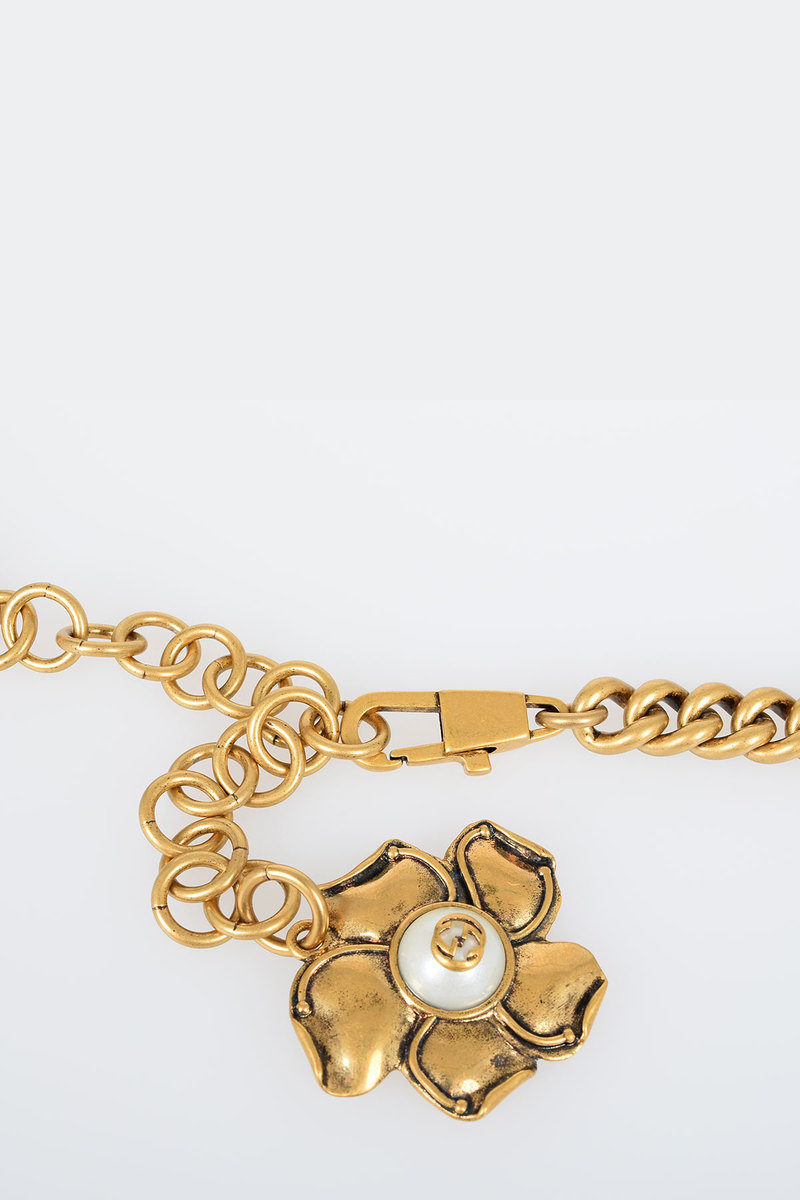cc414272625 Gucci Brass Belt with Floral Charm 15 mm women - Glamood Outlet
