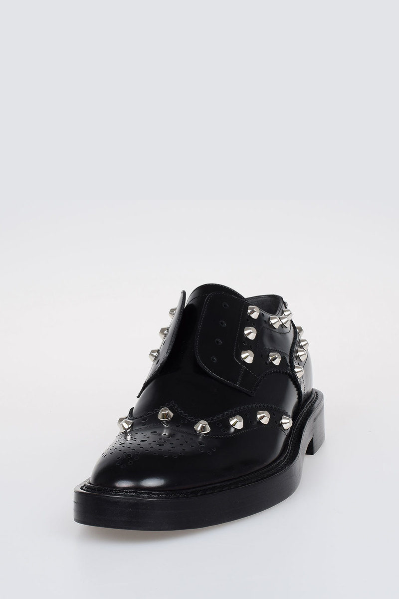 d6c9a68f9fbd9 Balenciaga Studded Wing-Tip Leather Derby Loafers women - Glamood Outlet